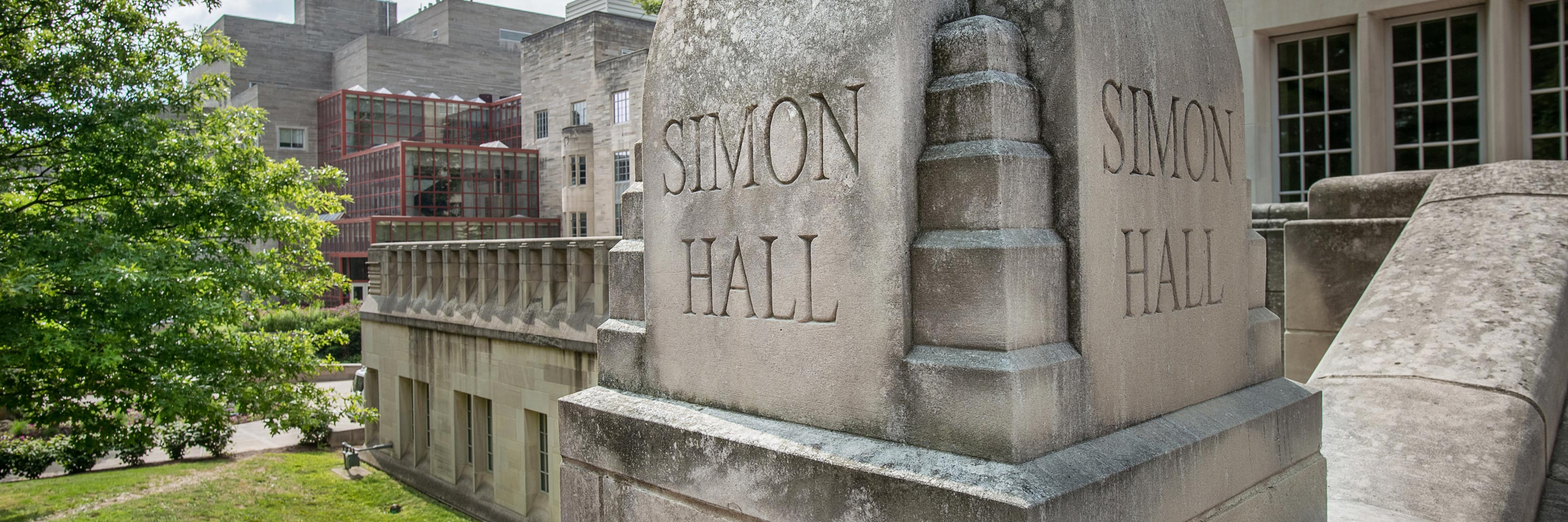 Outdoor view of Simon Hall and a tree
